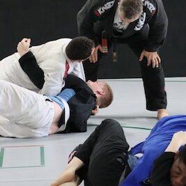 people training jiu jitsu at gym in Kansas City