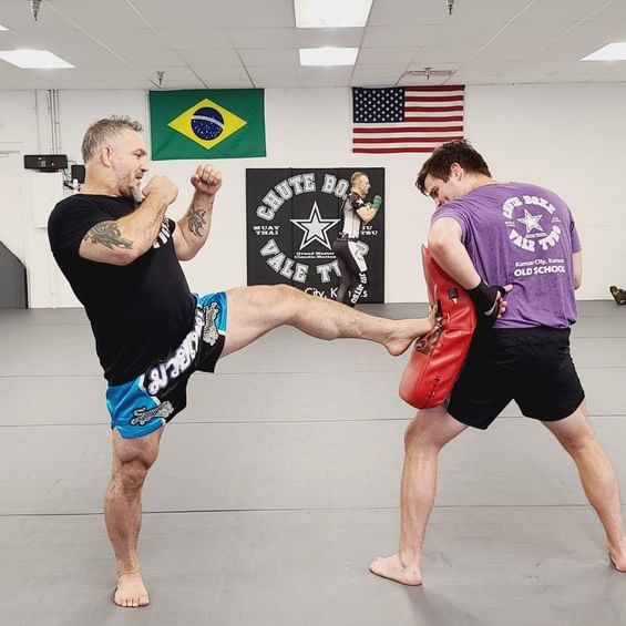 athletes working out at muay thai kickboxing gym in kansas city