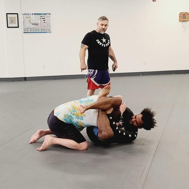 mma athletes training at fighter gym in Lenexa Kansas